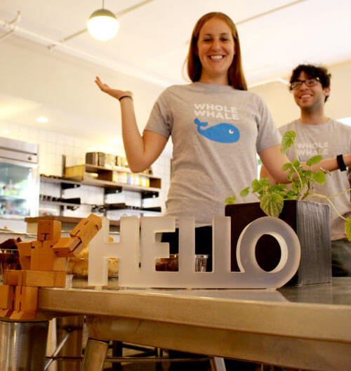 Whalers Enjoing the office space behind a hello sign